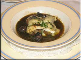 snails placed in hollowed out small potatoes and topped with melted brie