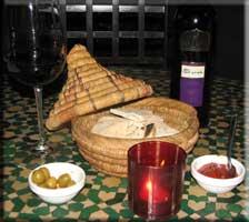 Halana Syrah, pita bread, olives, and harissa